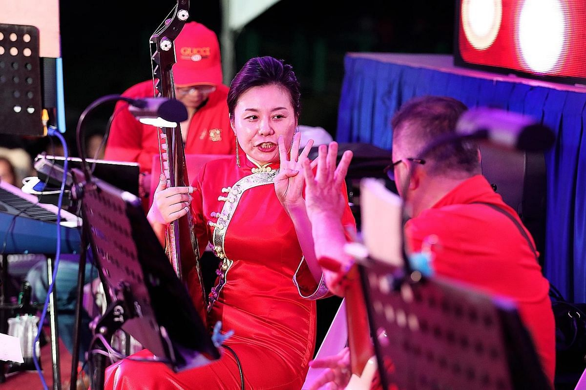 Funeral organiser Peh Chin Chye, 52, sings while Tai-Pan musicians provide back-up at a funeral.