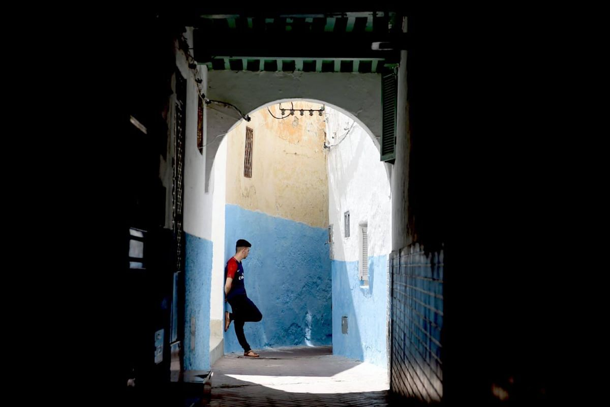 A man stands in the Old City of Morocco's port city of Tangiers, on Aug 13, 2018.