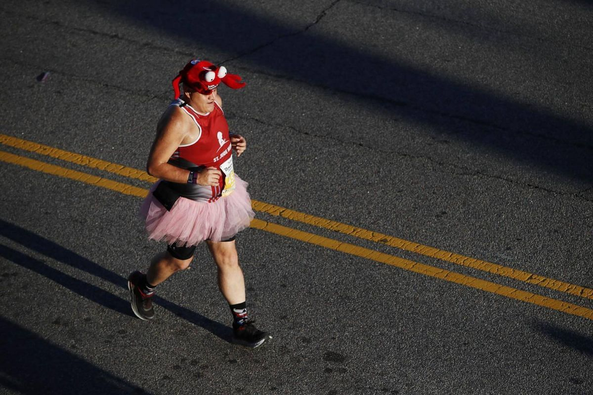 A runner competes in the 2018 Humana Rock 'n' Roll Virginia Beach half marathon on Sept 2, 2018.