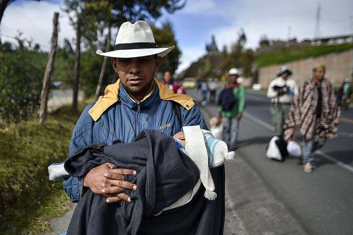 "Migrants sleeping along the Pan-American Highway in Ecuador, which has become home to about 40,000 Venezuelans. Hours before Peru imposed new entry restrictions last month, Ecuador opened a ""humanitarian corridor"" to allow the migrants to head toward"