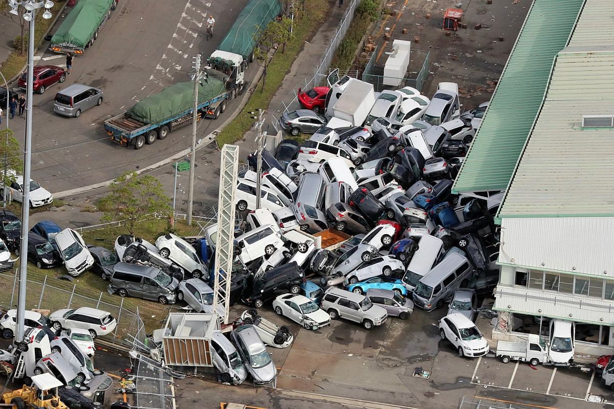 Cars piled up a day after powerful Typhoon Jebi hit the area in Kobe, western Japan, on Sept 5, 2018.