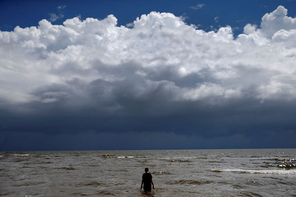 15-year-old Jordan Carambat wades in the ocean as Tropical Storm Gordon approaches Waveland, Mississippi, US, on Sept 4, 2018.