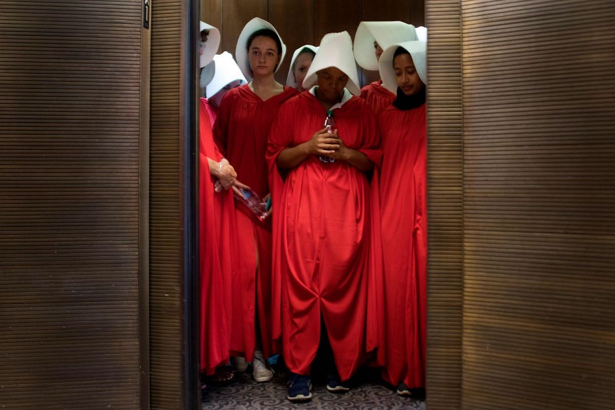 Women dressed as characters from the novel-turned-TV series The Handmaid's Tale stand in an elevator at the Hart Senate Office Building as Supreme Court nominee Brett Kavanaugh starts the first day of his confirmation hearing in front of the US Senat