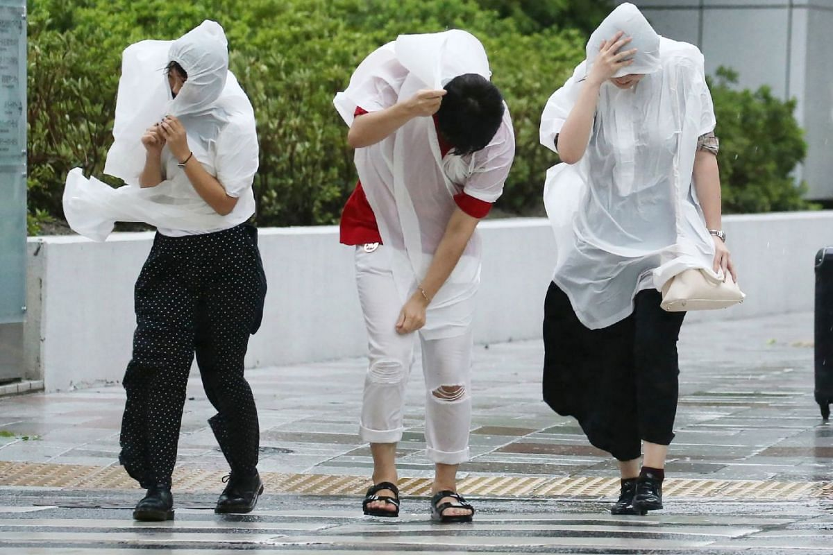 People battle against strong winds in Nagoya on Sept 4, 2018, as Typhoon Jebi made landfall in south-western Japan around midday.