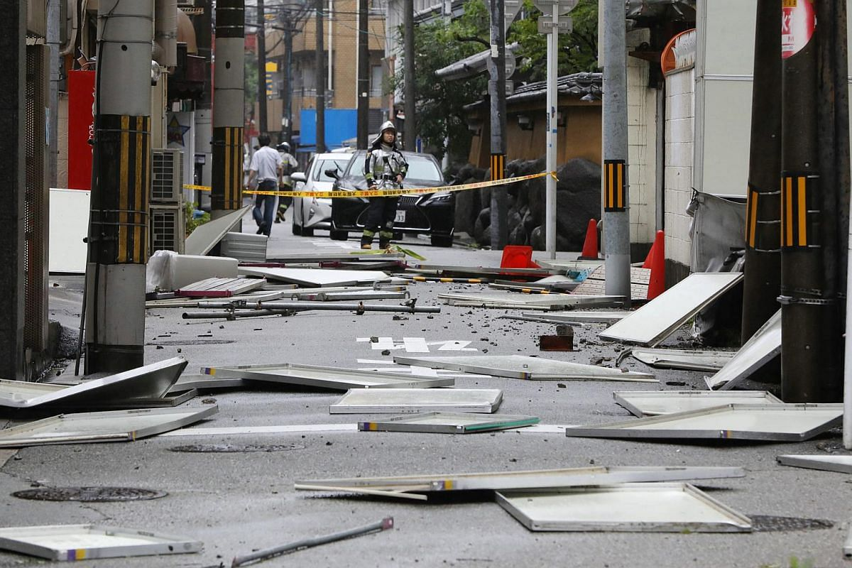 Broken panels litter the ground after coming loose during strong winds in Osaka, western Japan, on Sept 4, 2018.