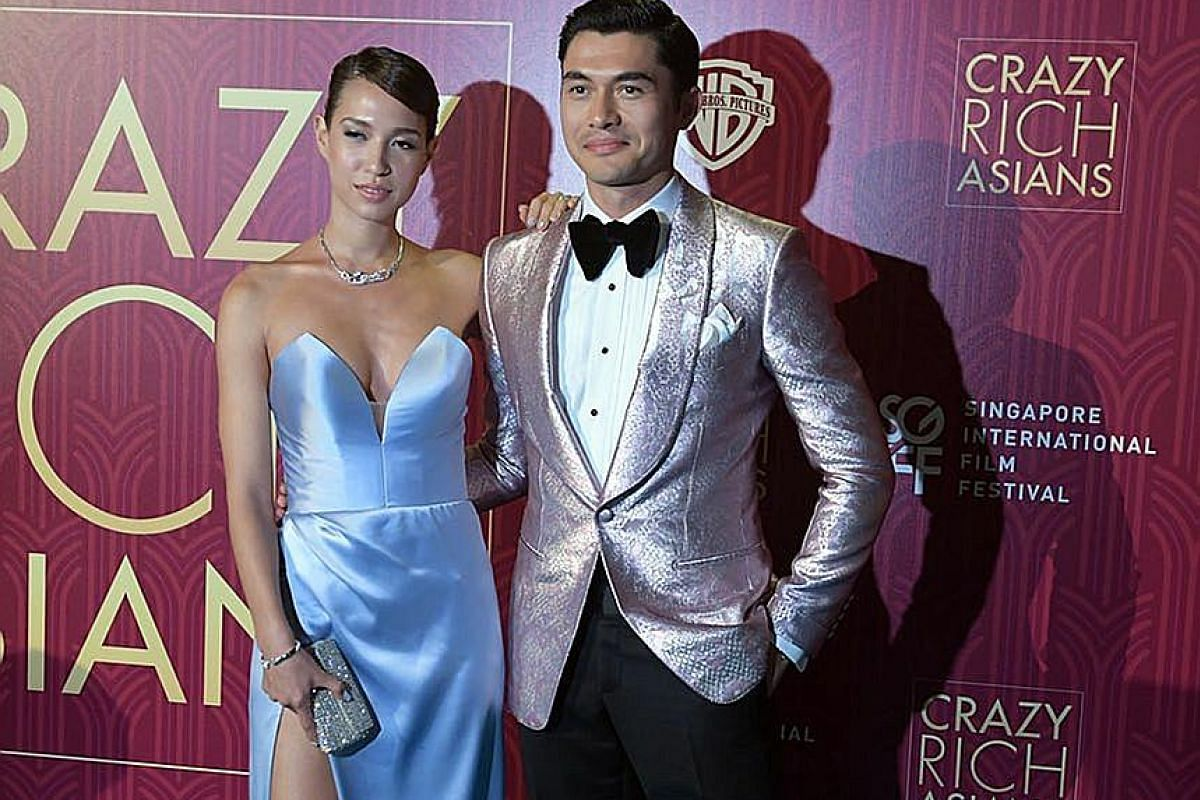 Henry Golding and his wife, Liv Lo, at the film premiere of Crazy Rich Asians in Singapore last month.