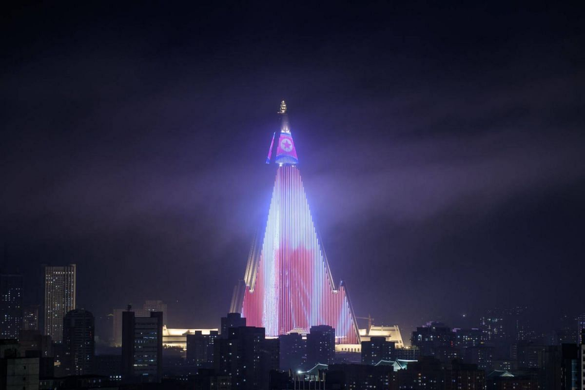 A light show is displayed on the Ryugyong hotel amid the city skyline, seen from the Yanggakdo hotel in Pyongyang, on Sept 5, 2018.