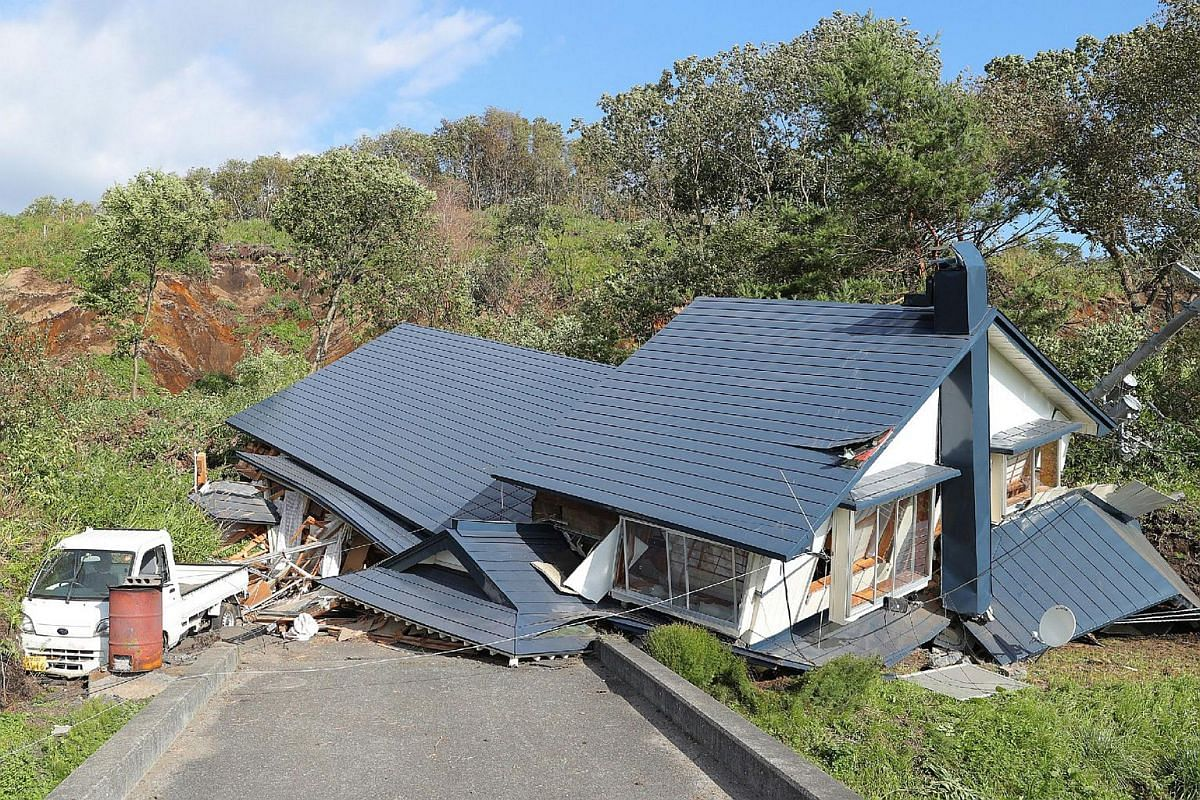 A house damaged by a landslide caused by an earthquake is seen in Atsuma town in Hokkaido prefecture on Sept 6, 2018.