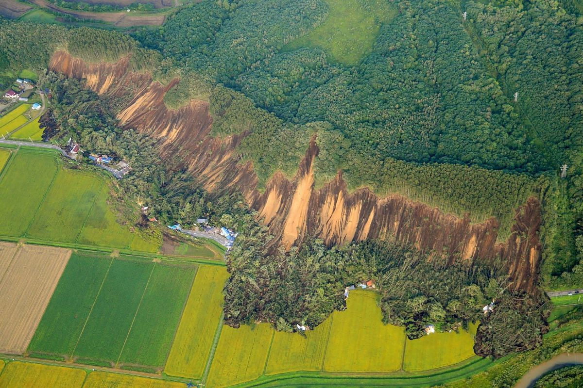 An aerial view of a landslide in Atsuma town, Hokkaido prefecture on Sept 6, 2018, after an earthquake hit the northern Japanese island of Hokkaido.