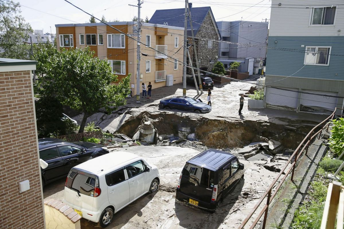 People look at an area damaged by an earthquake in Sapporo in Japan's northern island of Hokkaido, Japan, in this photo taken by Kyodo on Sept 6, 2018.