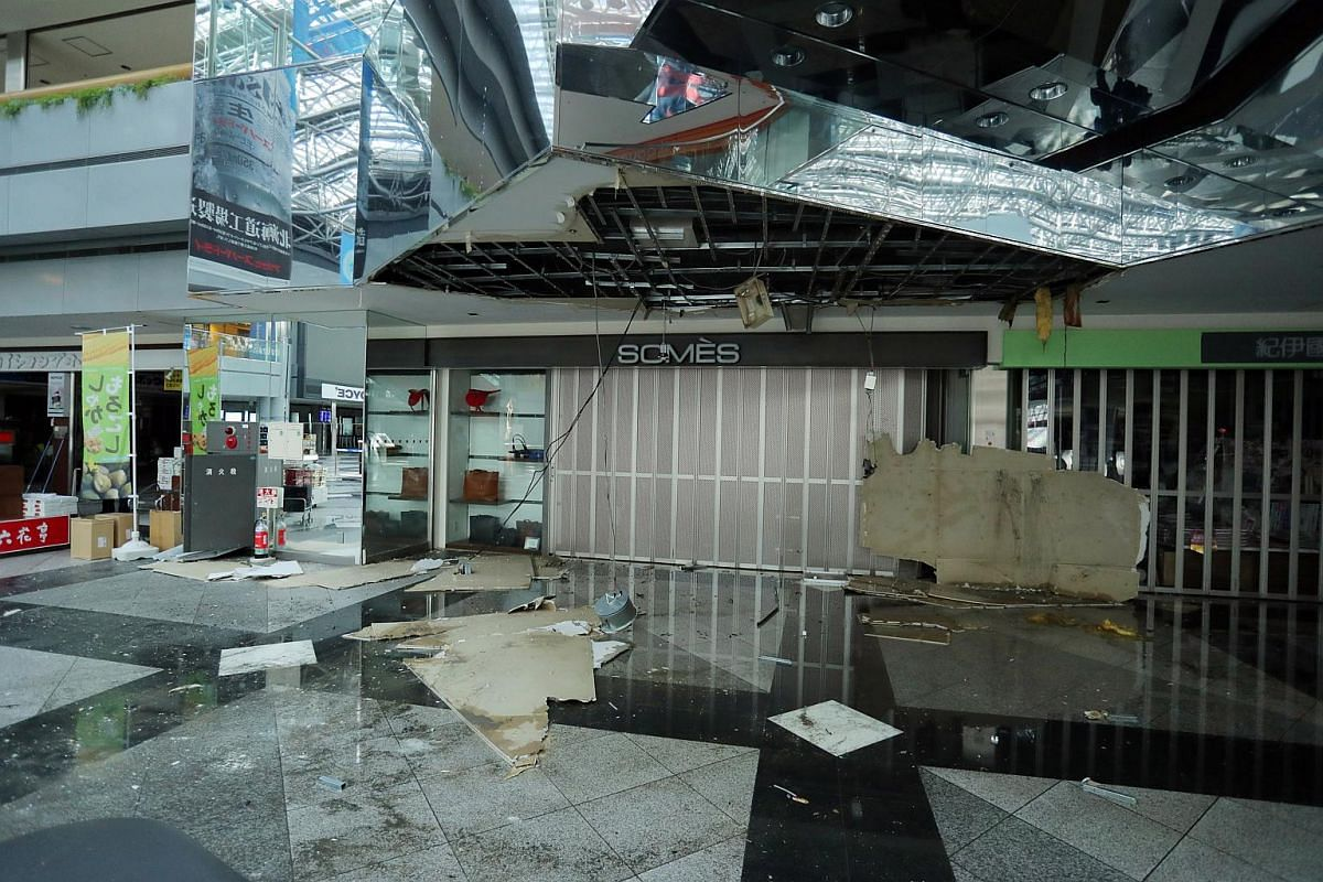 Broken glass and panels litter floor at New Chitose Airport following a strong earthquake in Chitose, Hokkaido, northern Japan, Sept 6, 2018.