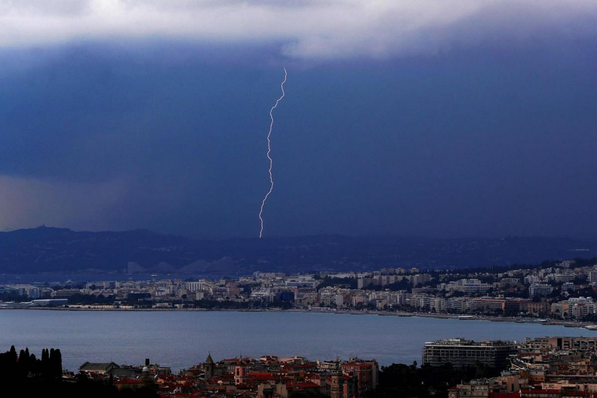 A flash of lightning strikes above the Baie des Anges in the French riviera city of Nice, south-eastern France on Sept 6, 2018.