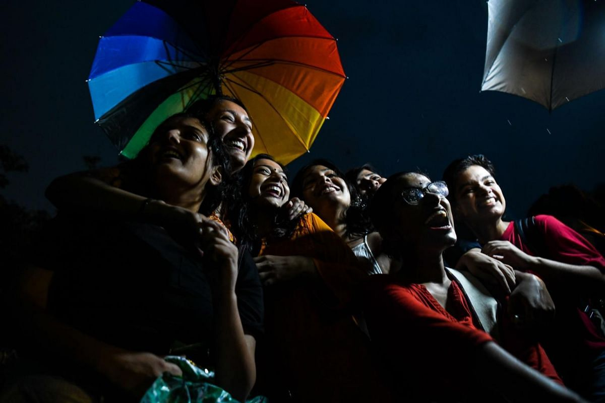 Indian members and supporters of the lesbian, gay, bisexual, transgender (LGBT) community celebrate the Supreme Court decision to strike down a colonial-era ban on gay sex, during heavy rainfall in New Delhi on Sept 6, 2018.