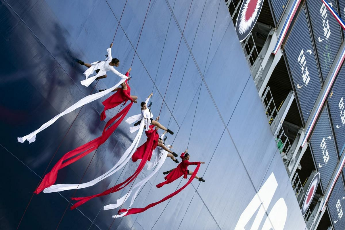 Artists perform on the hull of the CMA CGM Antoine de Saint Exupery container ship during its inauguration in Le Havre, France, on Sept 6, 2018.
