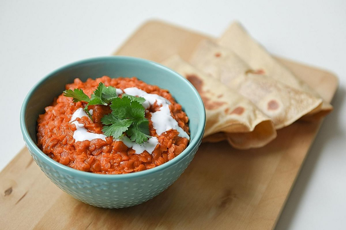 This Thai-and Indian-inspired red lentil curry is quick and easy to cook - and so satisfying.