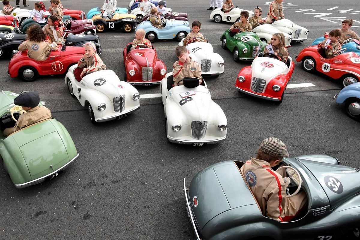 Children react after competing in a pedal car race as motoring enthusiasts attend the Goodwood Revival, a three day classic car racing festival celebrating the mid-twentieth century heyday of the sport, at Goodwood in southern Britain, on Sept 9, 201