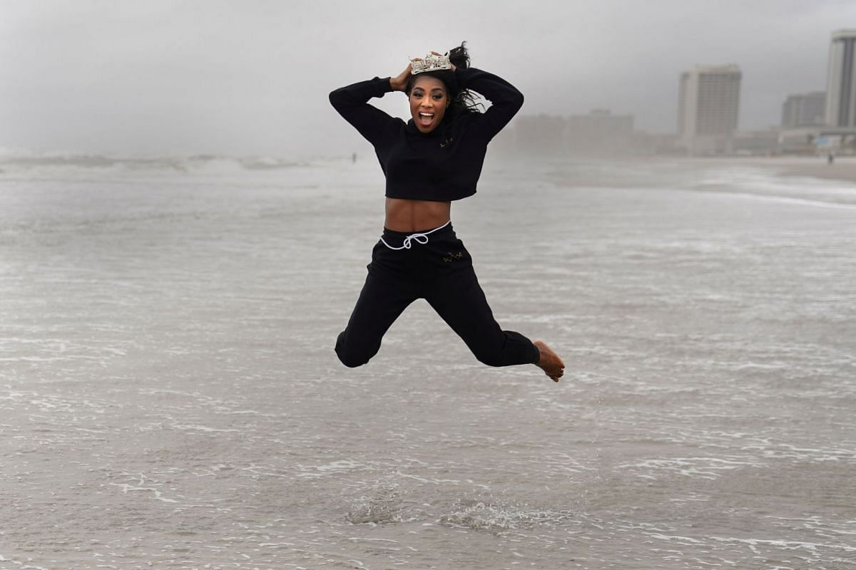 Miss America Nia Imani Franklin jumps as she poses for photos at the beach after she won Miss America, in Atlantic City, New Jersey, U.S., September 10, 2018. PHOTO: REUTERS
