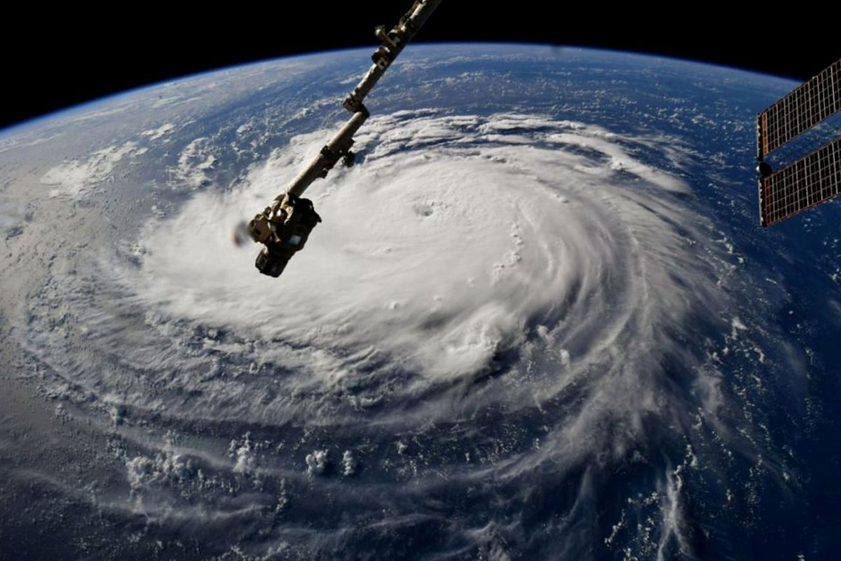 Hurricane Florence is seen from the International Space Station as it churns in the Atlantic Ocean towards the east coast of the United States, September 10, 2018. PHOTO: NASA HANDOUT VIA REUTERS