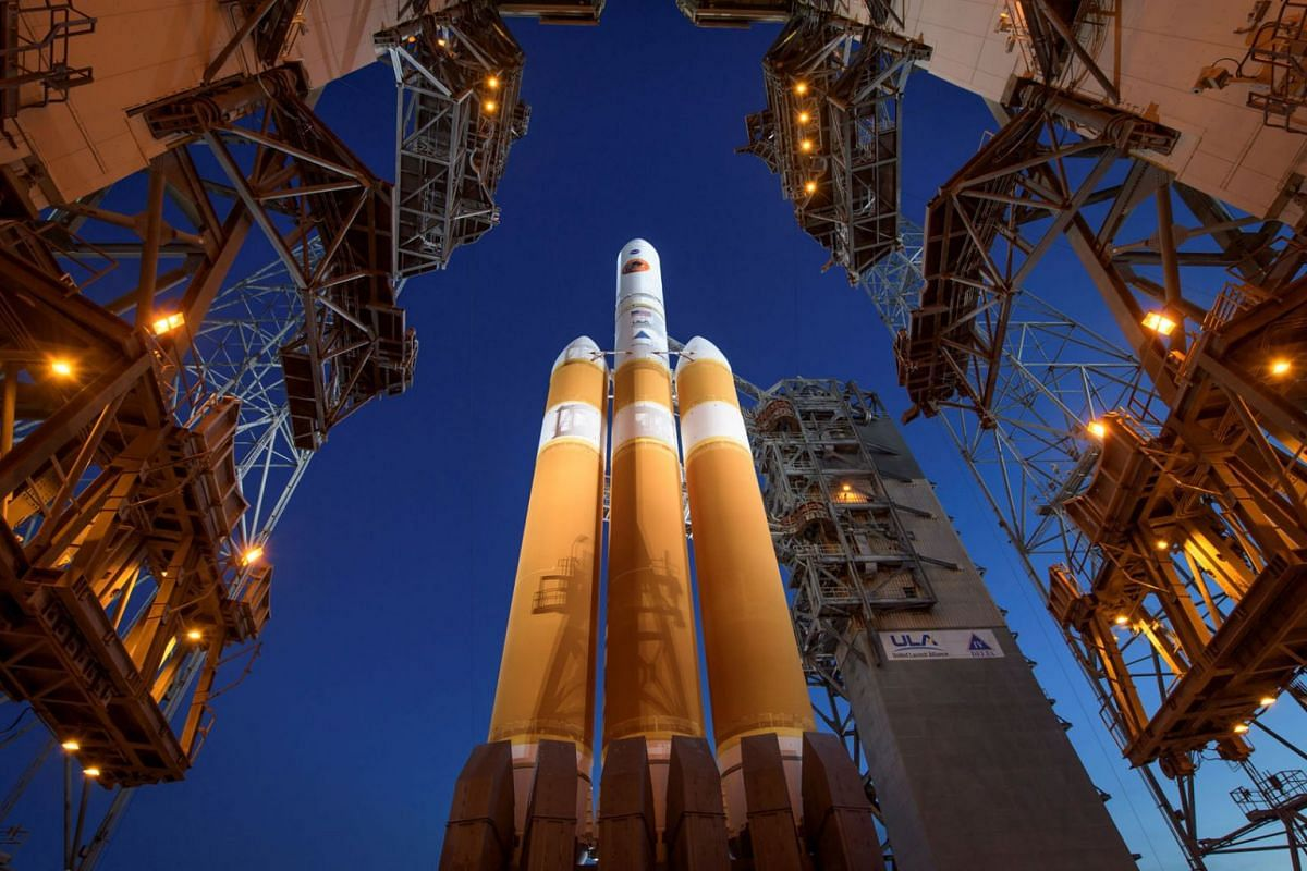 A photo provided by Bill Ingalls/Nasa and released on Sept 12, 2018, shows the Mobile Service Tower being rolled back to reveal the United Launch Alliance Delta IV Heavy rocket with Nasa's Parker Solar Probe onboard, at Cape Canaveral, Florida on Aug