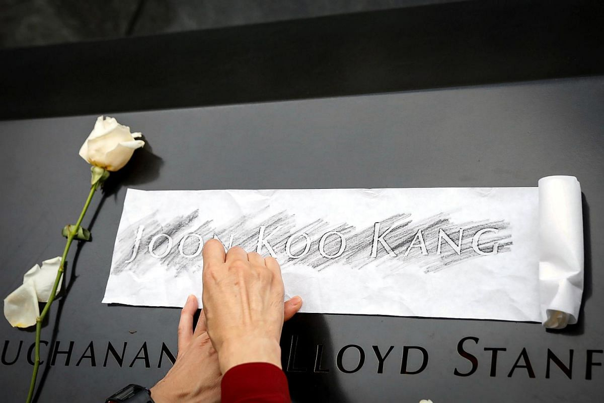 A guest makes an etching of a name on the National 9/11 Memorial during ceremonies marking the 17th anniversary of the 9/11 attacks on the World Trade Center, at the National 9/11 Memorial and Museum in New York, on Sept 11, 2018.
