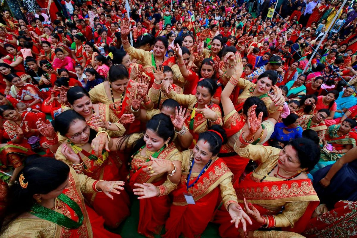 Nepali Hindu women dance during celebrations for the Teej festival in Chandigarh, India, September 12, 2018. PHOTO: REUTERS