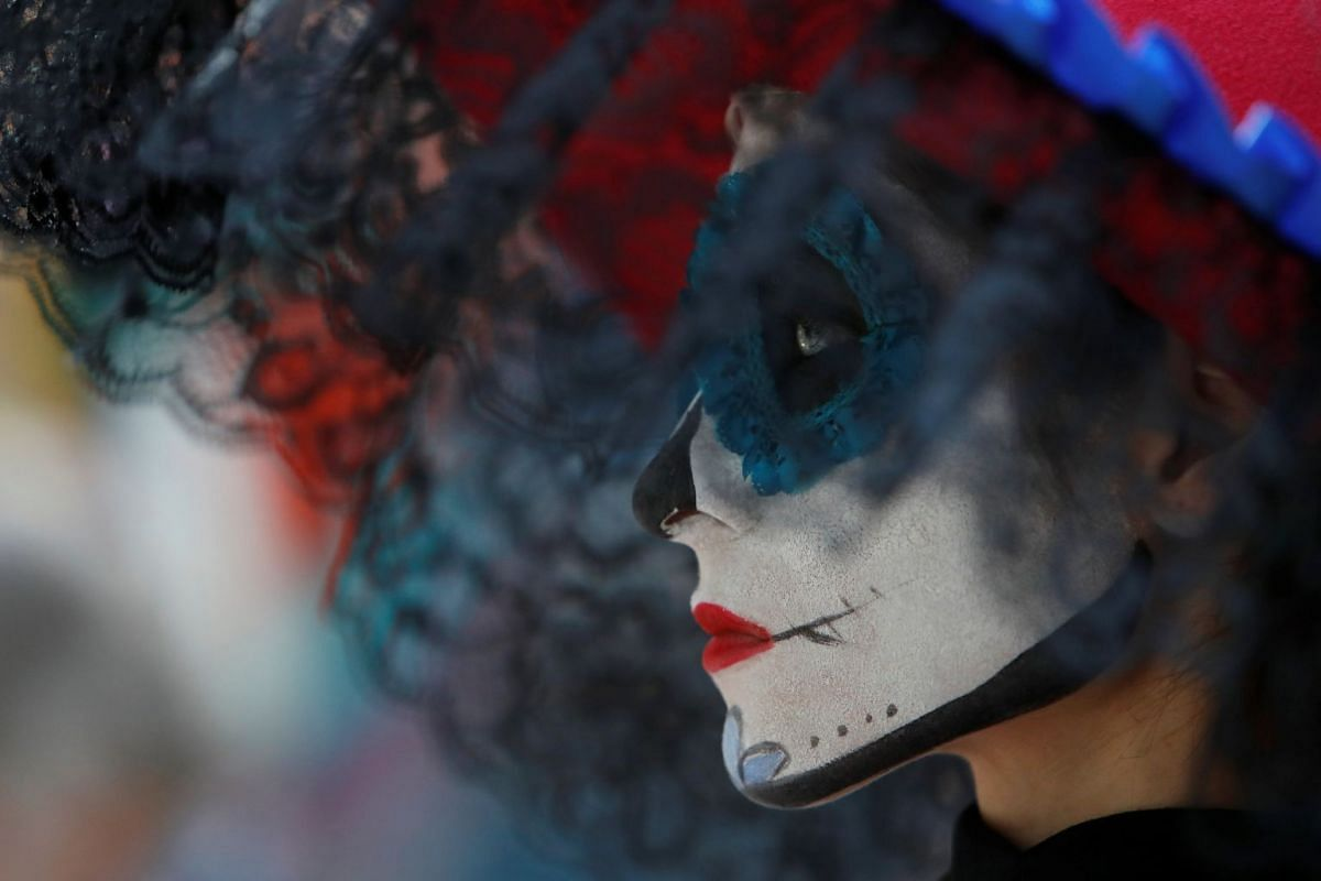 "A participant with a face painted as popular Mexican figure ""Catrina"" attends the Day of the Dead event at a National house for Mexican fans in central Moscow, a host city for the 2018 FIFA World Cup, Russia June 29, 2018. PHOTO: REUTERS"