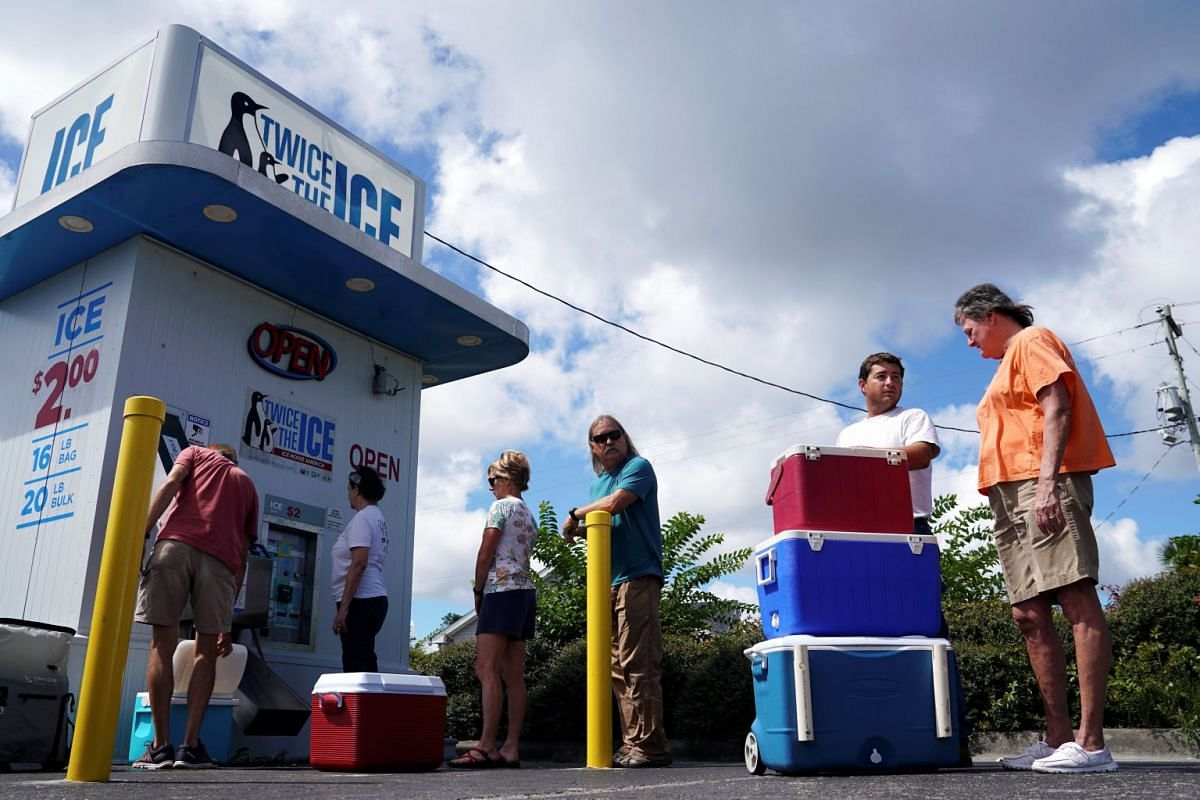 People lining up for ice before Hurricane Florence comes ashore in Carolina Beach, North Carolina.