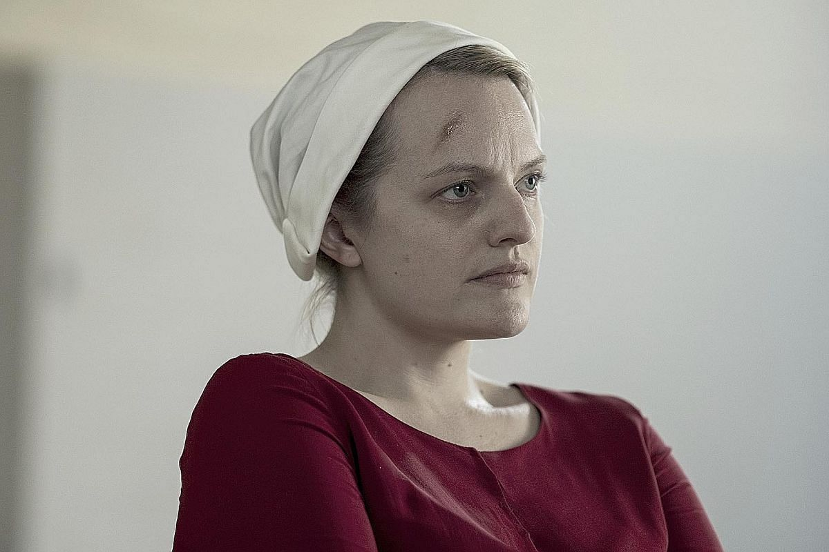 Actress Elisabeth Moss (above) in The Handmaid's Tale. A co-producer of the series, she and show creator Bruce Miller (both left), won the Golden Globe for Best Television Series Drama earlier this year.