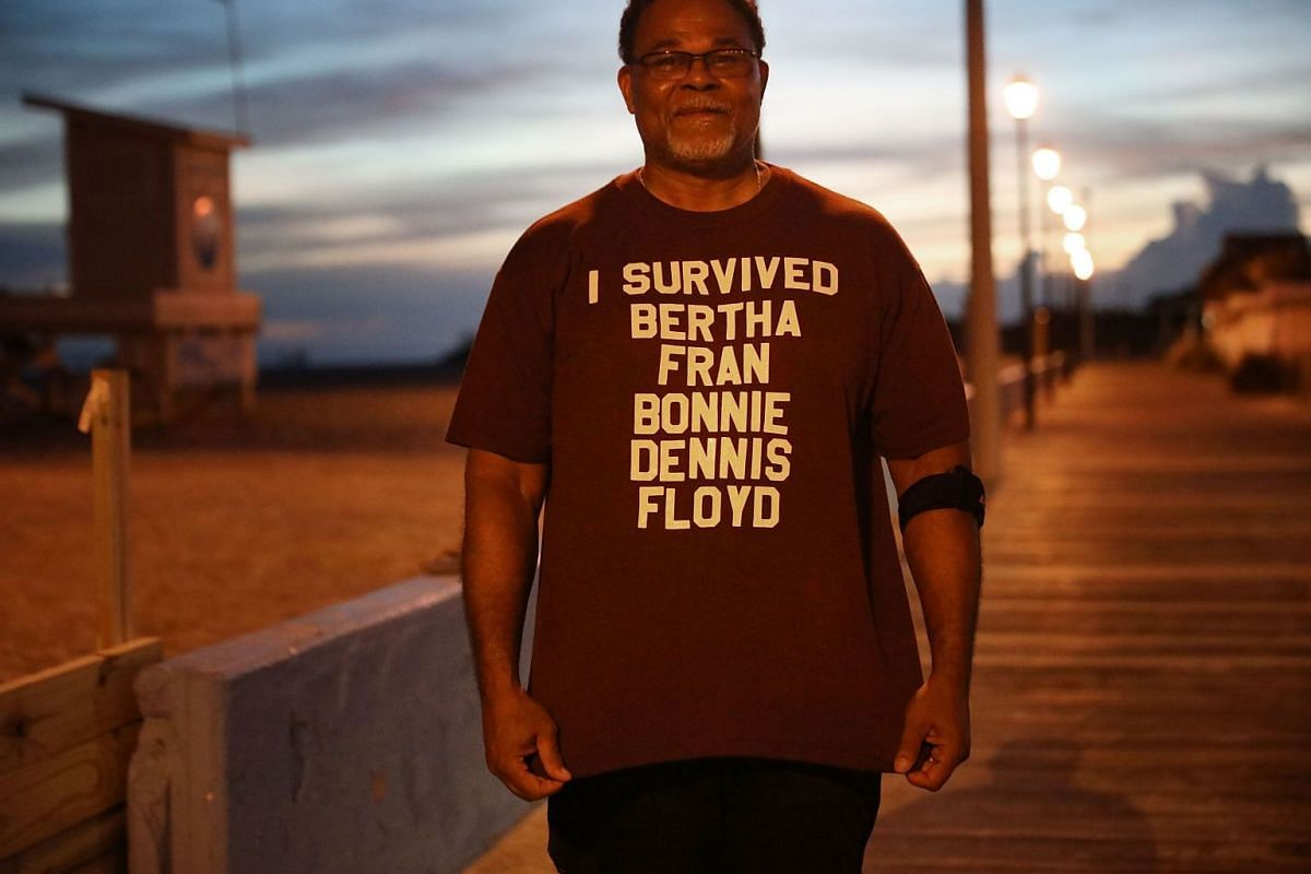 North Carolina resident Al Brookins poses with his shirt that lists some of the previous hurricanes that he has lived through as he awaits Hurricane Florence's impending arrival.