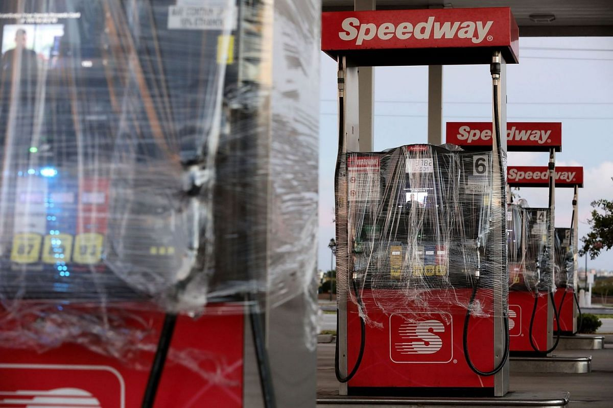 Gasoline pumps in North Carolina are wrapped in plastic to prevent people from using them at a closed station before the arrival of Hurricane Florence, on Sept 12, 2018.