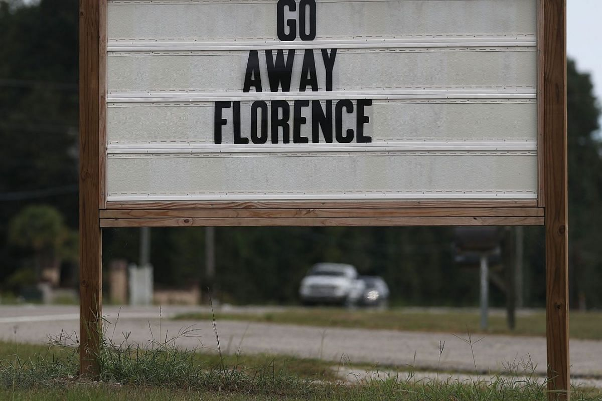 """A sign in South Carolina's Myrtle Beach reads: """"Go Away Florence""""."""