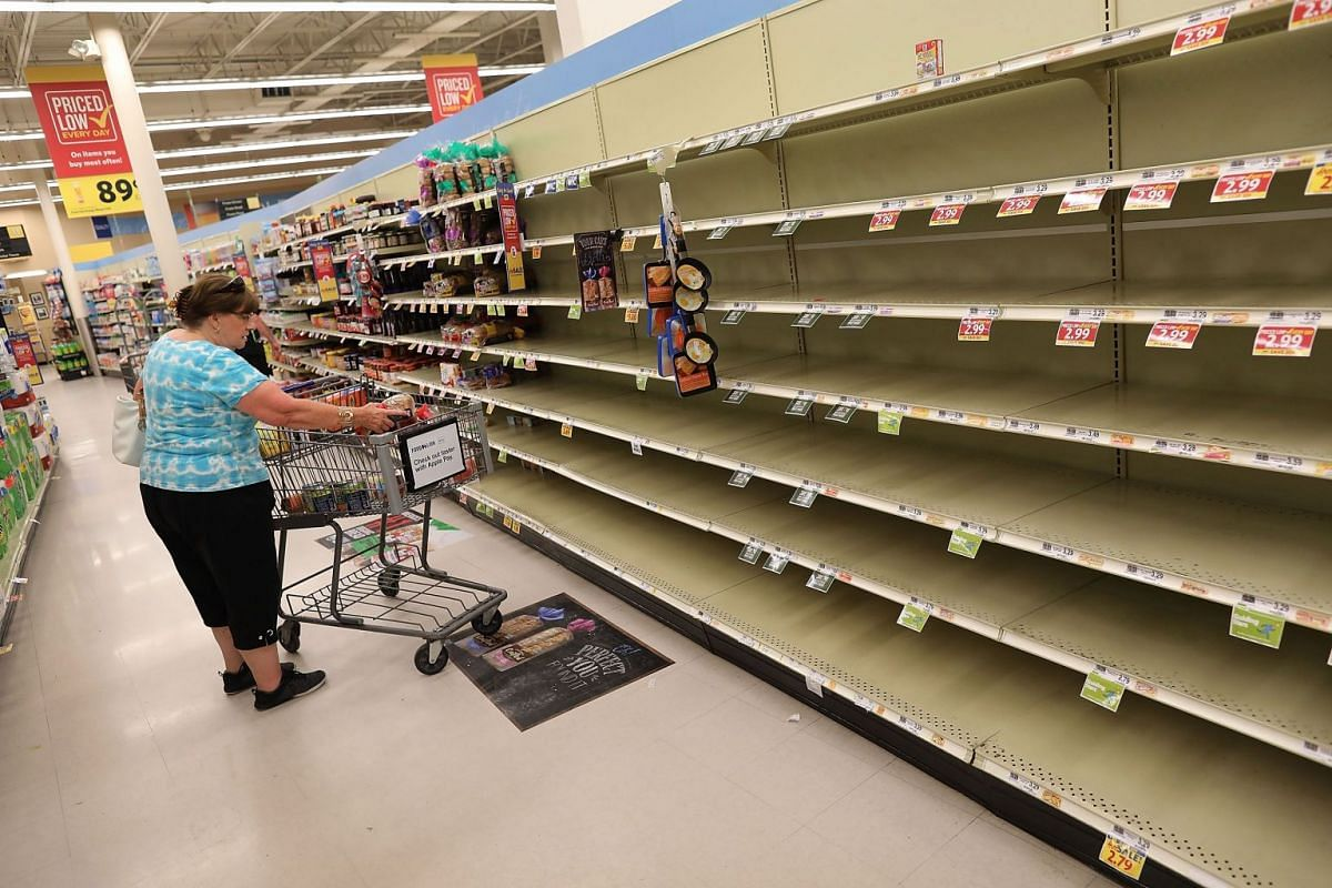 Bread shelves in a grocery store in South Carolina are empty as people stock up on food ahead of the arrival of Hurricane Florence on Sept 12, 2018.