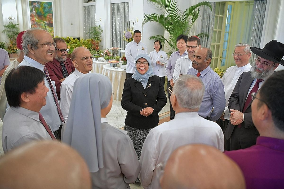 President Halimah with members of the Inter-Religious Organisation at a buffet brunch in the Istana's Reception Room on Sept 28 last year. With the President are (clockwise from centre left) Sister Theresa Seow (back facing camera), Mr Kuek Yi Hsing,