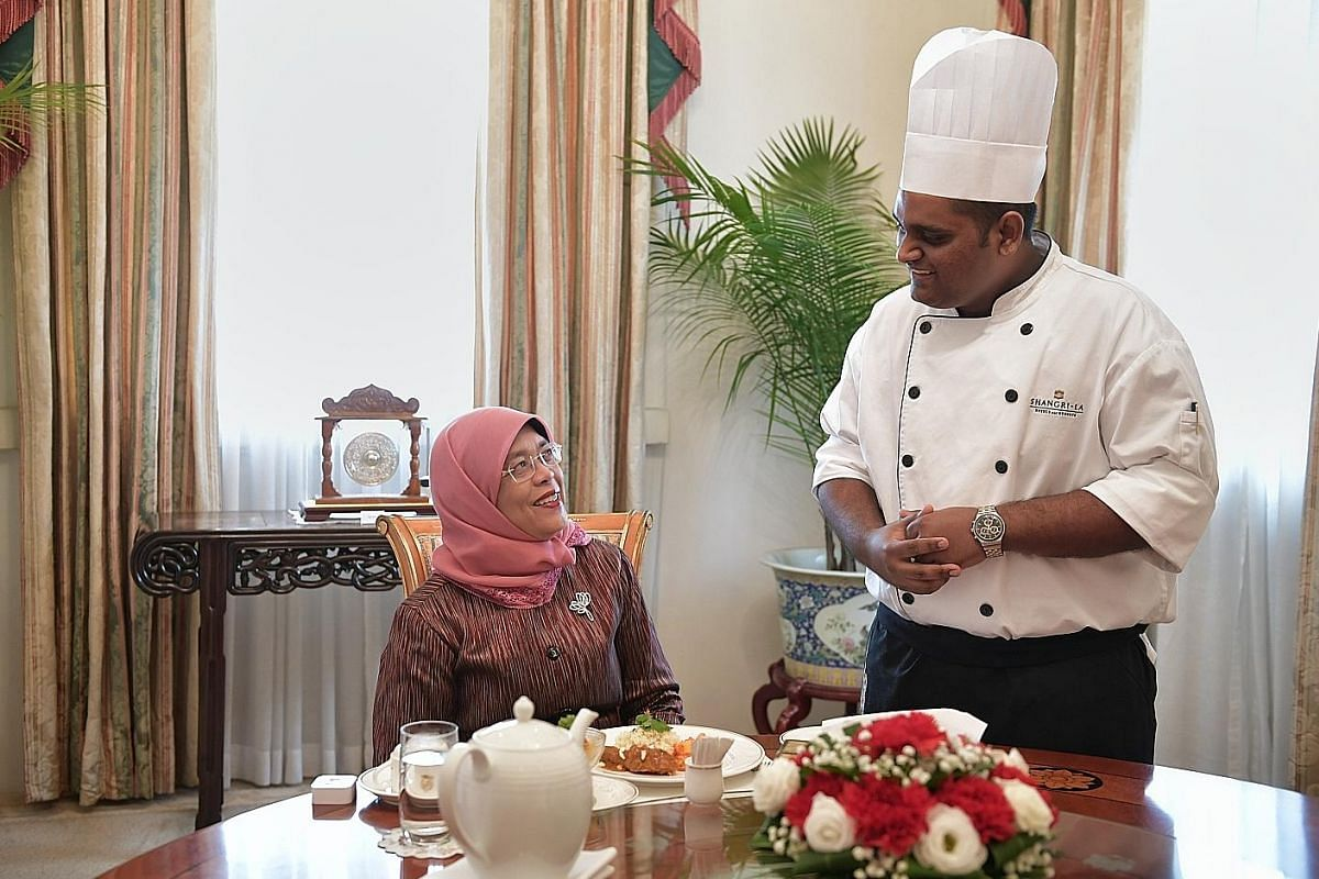 President Halimah with Mr Paul Simon before tucking into a meal prepared by him at the Istana on Jan 24. She reached out to him after reading a report in The Straits Times about his wish to cook for her. Mr Simon, who works at a hotel and has mild in