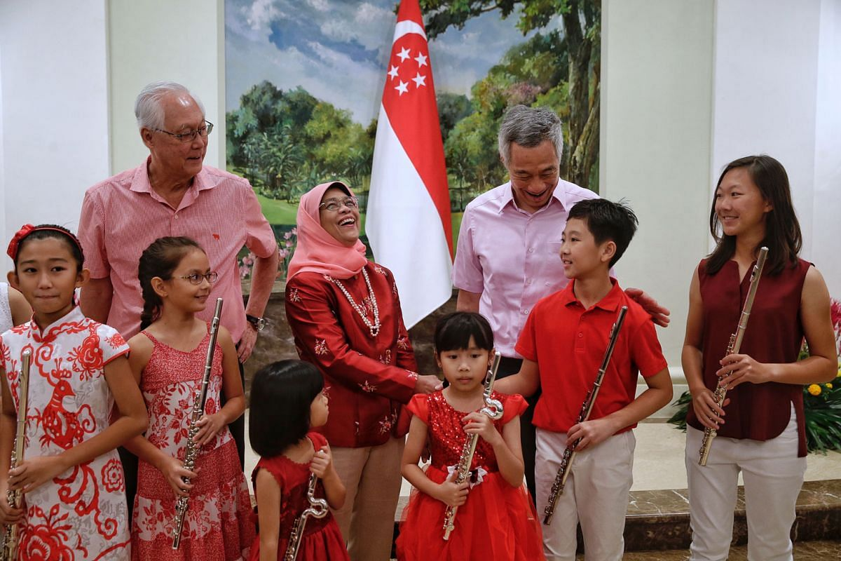 Young flute performers (from left) Renee Koh, Nadia Chan, Beverley Ng, Yew Jing Yun and Joshua Yip meeting President Halimah, Prime Minister Lee Hsien Loong and Emeritus Senior Minister Goh Chok Tong at the Istana on Aug 8.