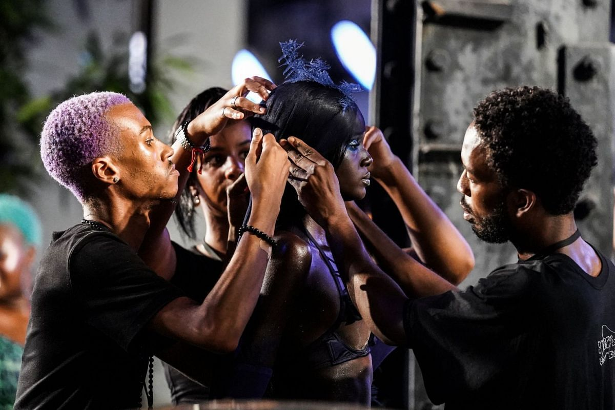 A model receives final touches on the stage before the Savage X Fenty event in New York City, on Sept 12, 2018.