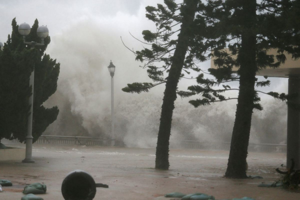 High waves hit the shore at Heng Fa Chuen, a residential district near the waterfront, as Typhoon Mangkhut slams into Hong Kong on Sept 16, 2018.