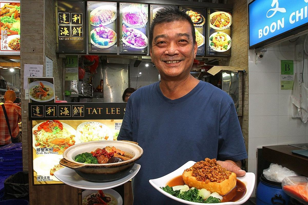 Tat Lee Seafood owner Sing Cheo Liang with its Treasure Pot Kampung Chicken (far left) and Cai Xiang Tofu, which are not on the menu. Fatty Fong Seafood Restaurant head chef Tan Woei Lum and his sister and stall ownerTan Yoke Fong with their Sea