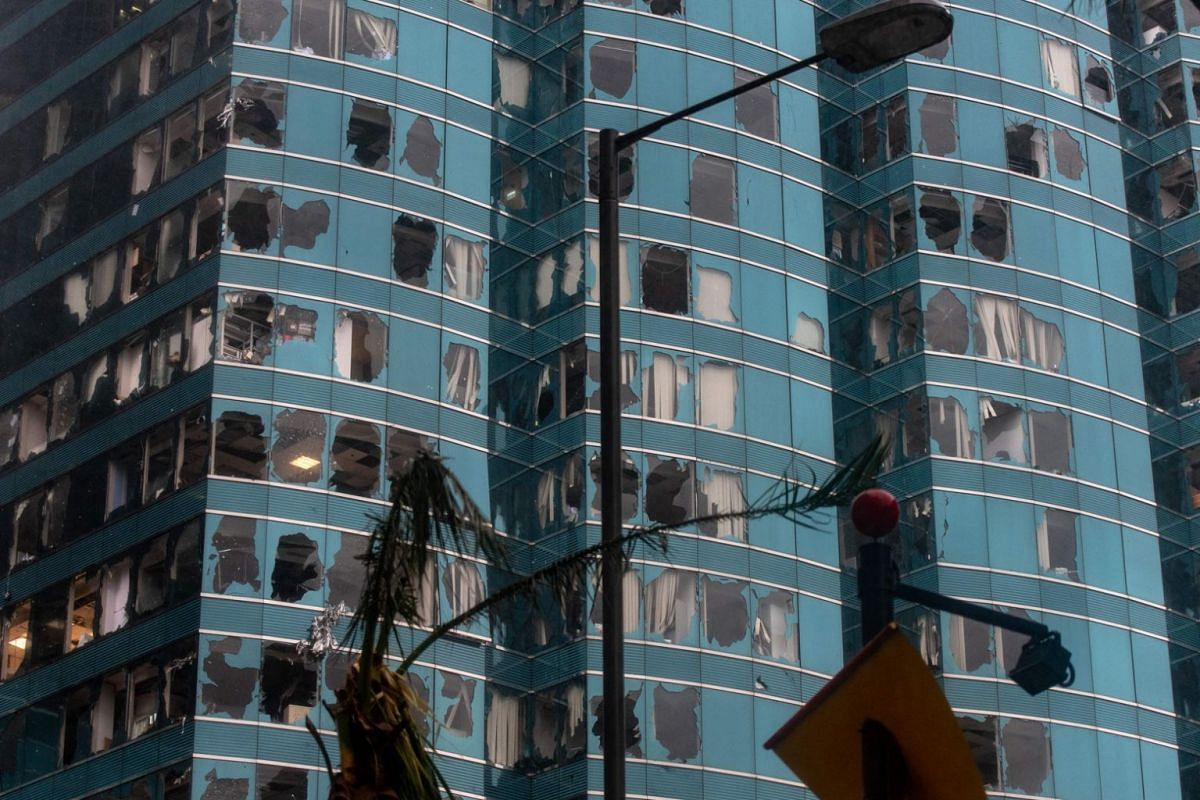 Damaged windows of the One Harbourfront office tower are seen following Typhoon Mangkhut in Hong Kong on Sept 16, 2018.