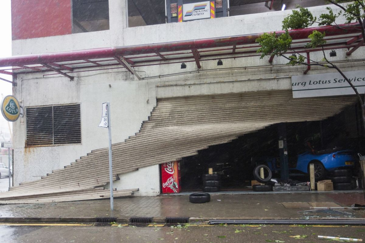 A Lotus sports car service centre has its gate ripped off during Typhoon Mangkhut in Hong Kong on Sept 16, 2018.