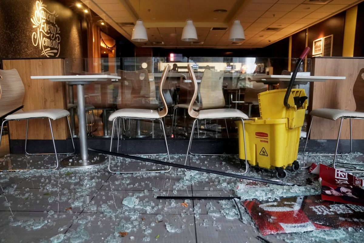Broken glass is seen in a restaurant as Typhoon Mangkhut makes landfall in Shenzhen, in China's Guangdong province, on Sept 16, 2018.