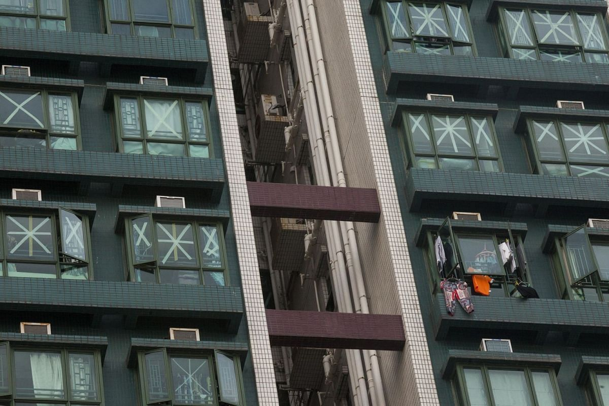 Windows of a residential building are taped up in preparation for the arrival of Typhoon Mangkhut in Hang Hau, New Territories, Hong Kong,  on Sept 15, 2018.