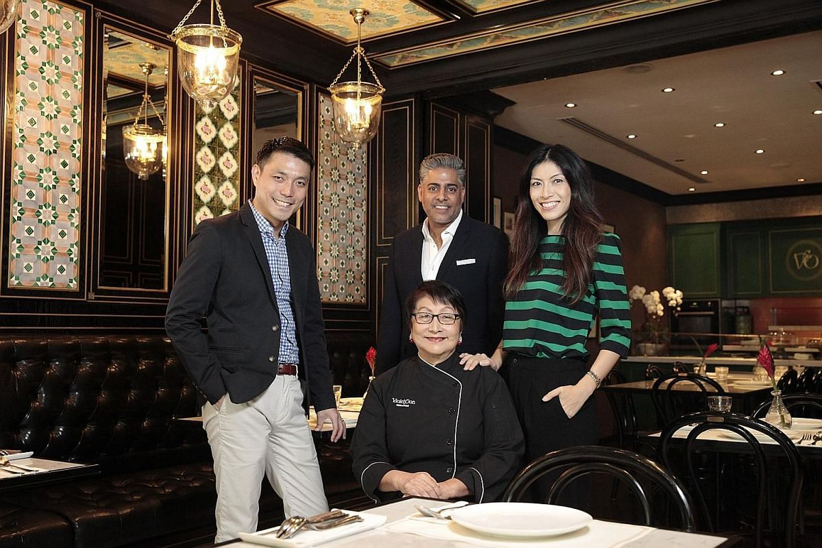 Violet Oon (seated) with her team - (from far left) son Tay Yiming, business partner Manoj Murjani and daughter Tay Su-lyn - who plan to take her brand to the world stage.