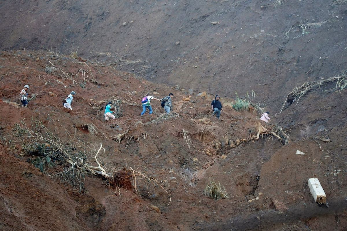 A road eroded by a landslide caused by Super Typhoon Mangkhut at a mining camp in Itogon, the Philippines, on Sept 18, 2018.