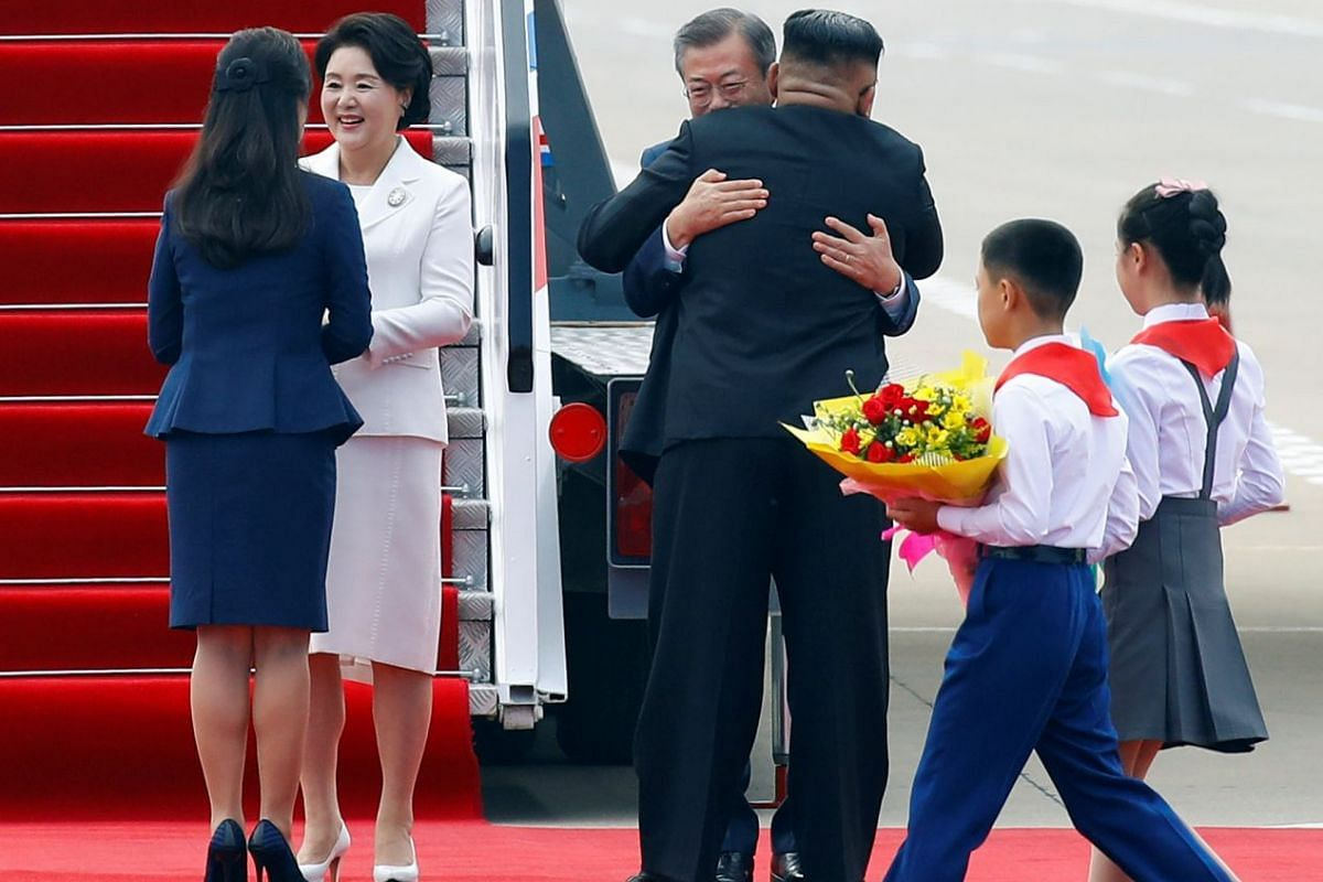 South Korean President Moon Jae-in and North Korean leader Kim Jong Un attend an official welcome ceremony at Pyongyang Sunan International Airport, in Pyongyang, on Sept 18, 2018.
