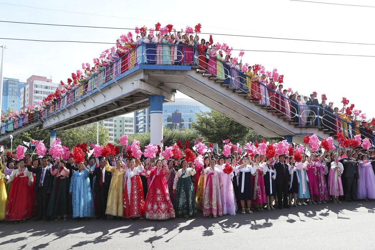 North Korean people greet South Korean President Moon Jae-in and North Korean leader Kim Jong Un during a car parade in Pyongyang, on Sept 18, 2018.