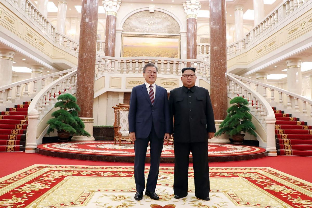 North Korean leader Kim Jong Un (right) poses with South Korean President Moon Jae-in before their summit, at the Workers' Party of Korea headquarters in Pyongyang, on Sept 18, 2018.