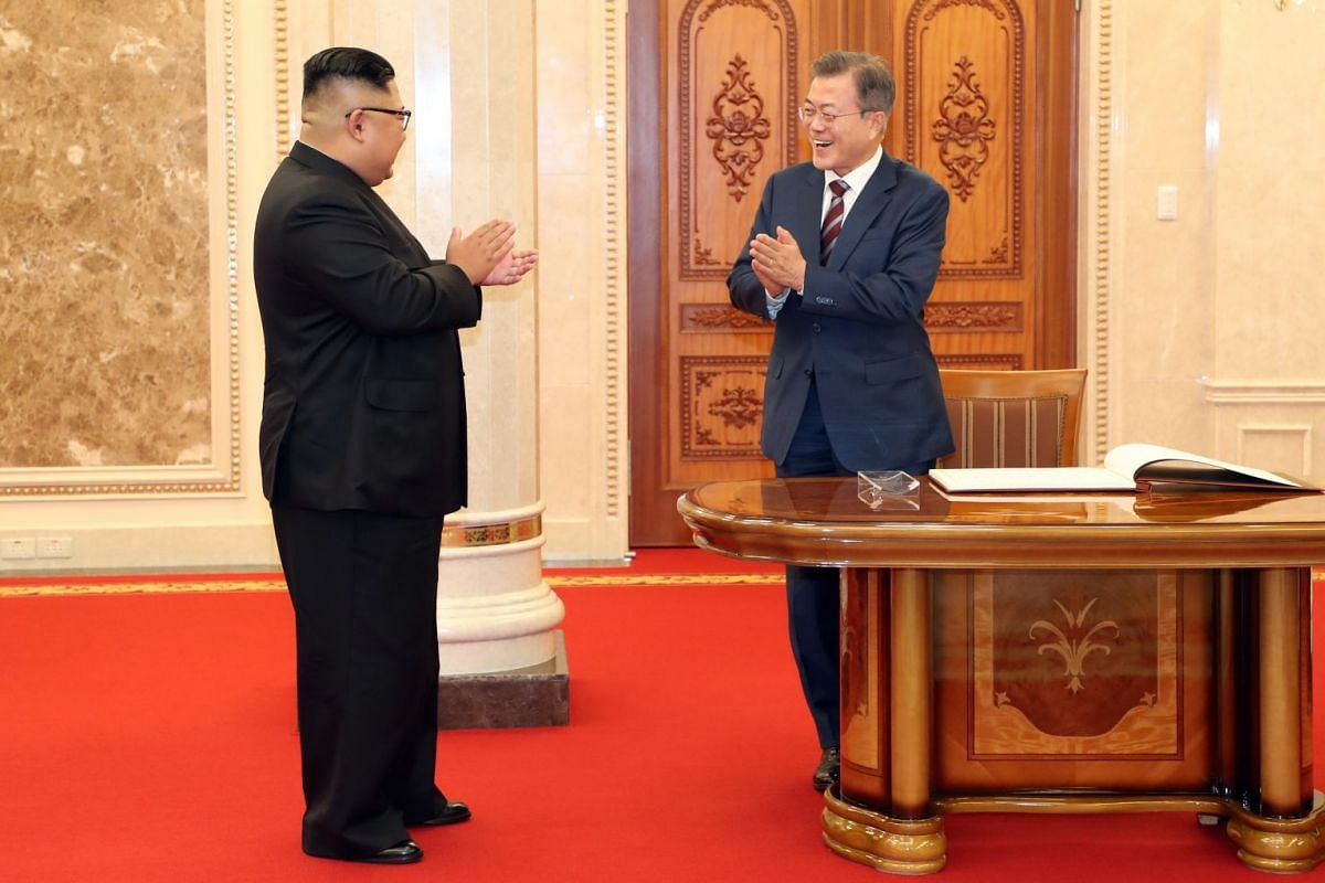 South Korean president Moon Jae-in (right) and North Korean leader Kim Jong Un prior to their meeting at the Labor Party Office in Pyongyang, on Sept 18, 2018.