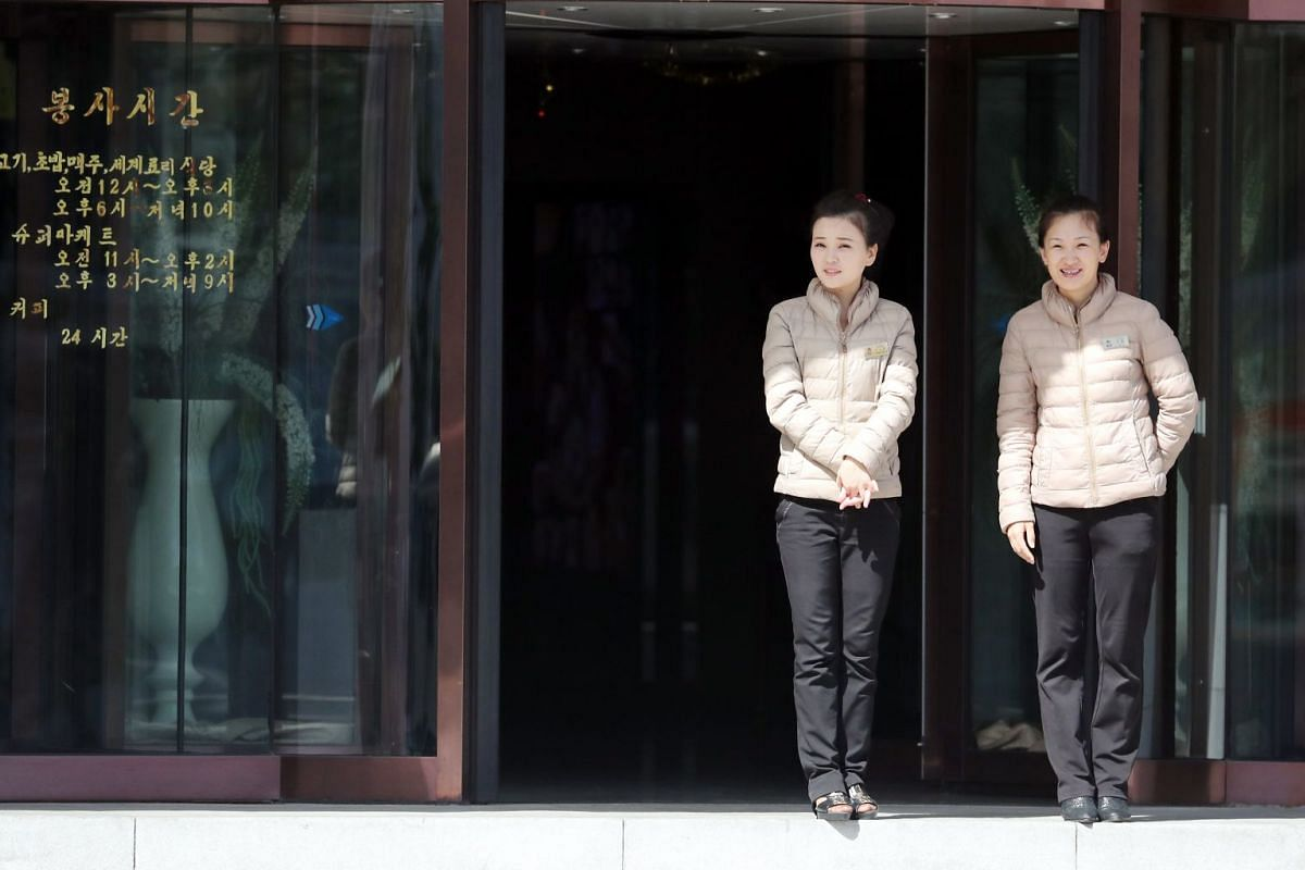 North Korean women stand at the entrance to a building in Pyongyang, on Sept 18, 2018.