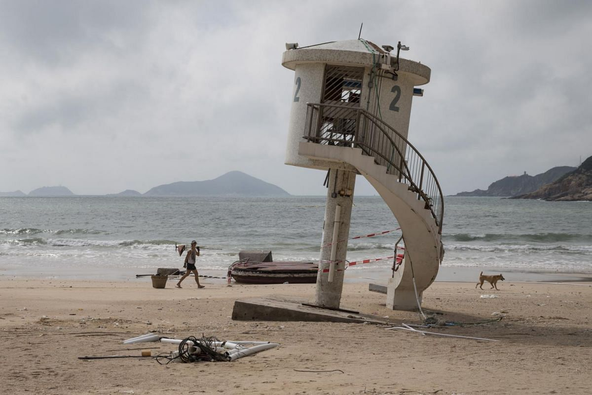 A lifeguard tower on the beach in Shek O, Hong Kong, is left tilted by Super Typhoon Mangkhut on Sept 18, 2018.